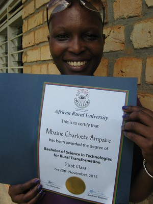 ARU Graduate Charlotte Mbaine Ampaire holding her Degree